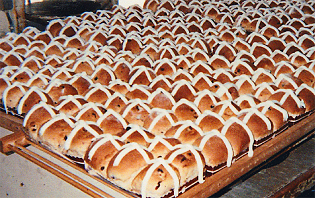 Trays of freshly frosted hot cross buns.